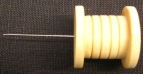 Magnet för nålar i ask.